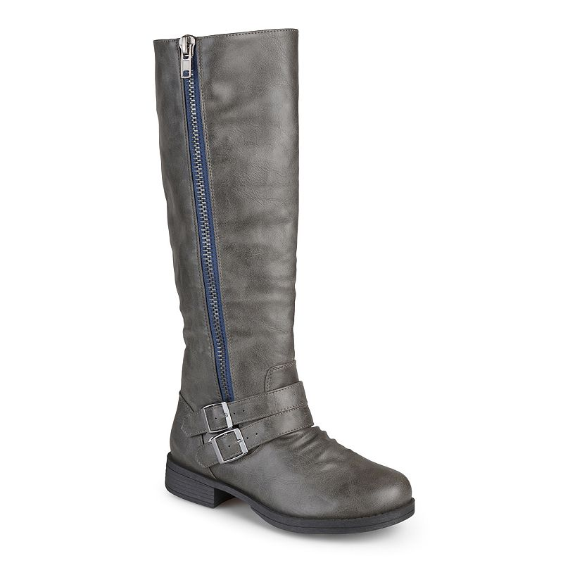 Product Features Tall snow boot featuring faux-shearling facing at vamp and collar.