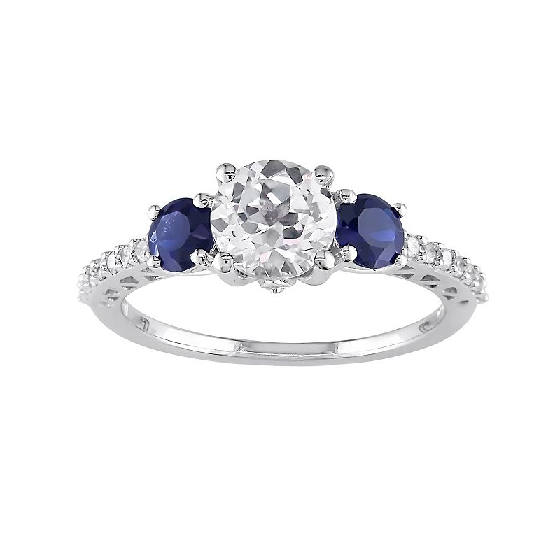 Lab-Created Blue and White Sapphire and Diamond 3-Stone Engagement Ring in 10k White Gold (.14 ct. T.W.)