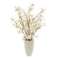 Click here to buy Designs by Lauren Artificial Dogwood Flower Arrangement in Embossed Vase.