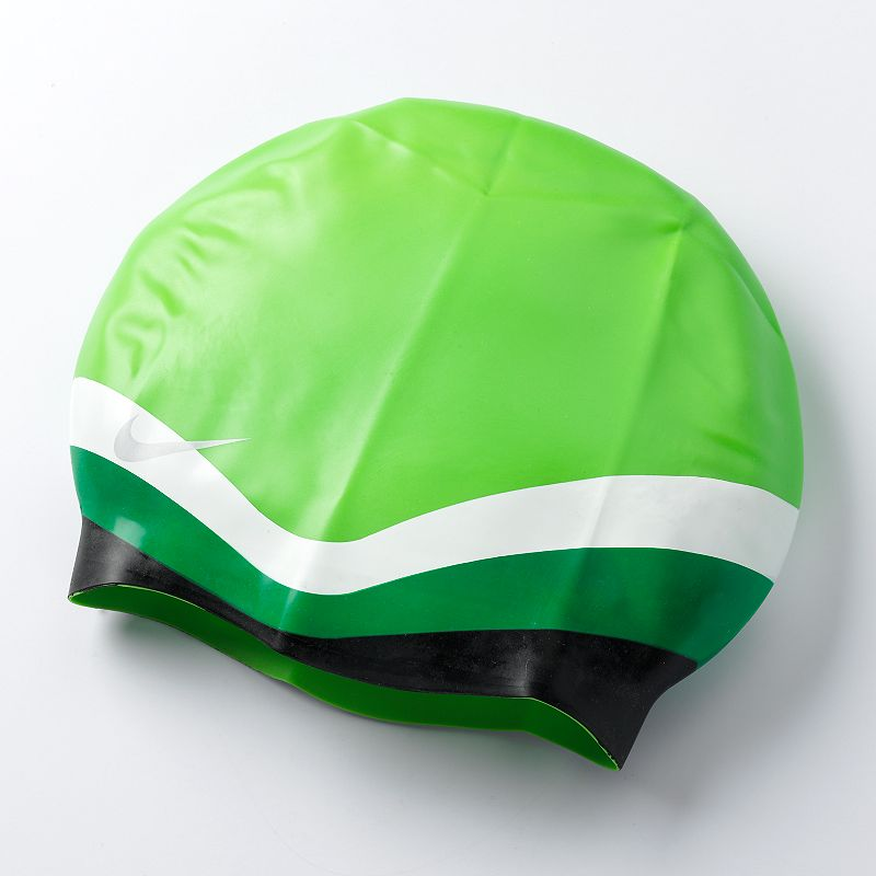 Nike Flat Swim Cap, Green Silicone construction is easy on hair. Details: One size fits most Silicone Imported Color: Green. Gender: Unisex. Age Group: Adult. Pattern: Color Block.