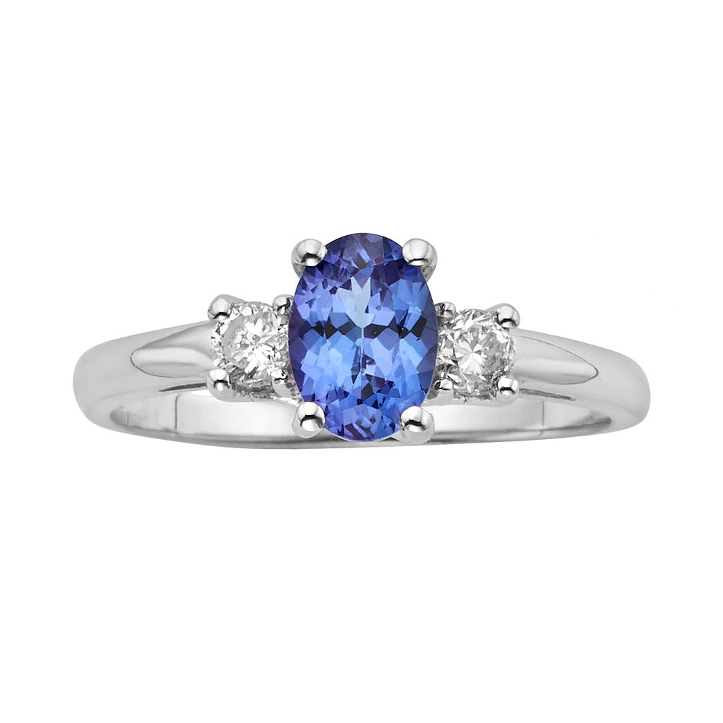 The Regal Collection Genuine Tanzanite & 1/5 Carat T.W. Diamond 14k White Gold 3-Stone Ring