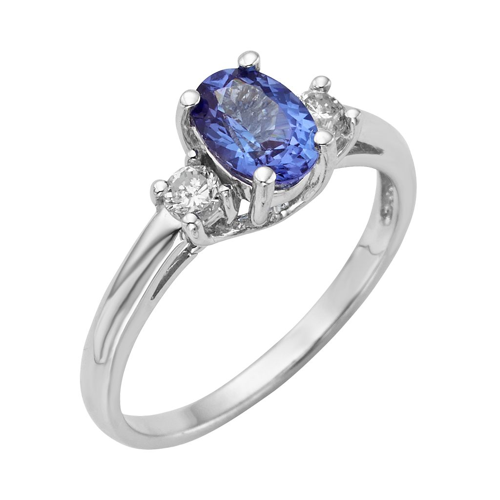 The Regal Collection Genuine Tanzanite and 1/5 Carat T.W. Diamond 14k White Gold 3-Stone Ring