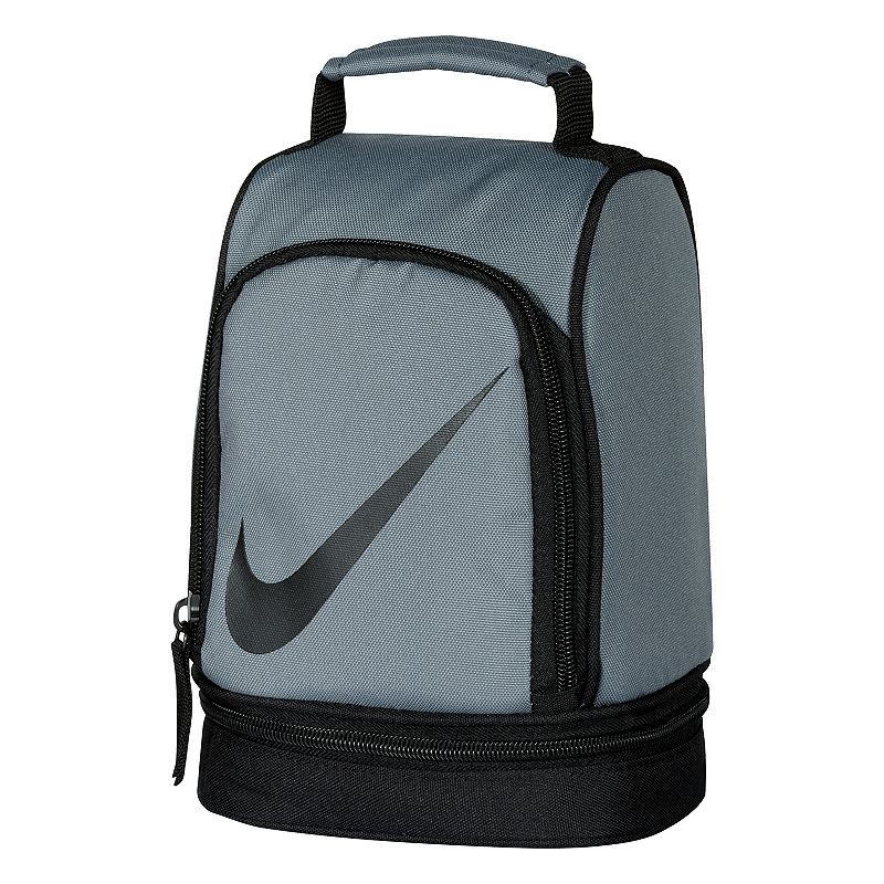 Nike Dome Lunch Bag, Grey : Padded handle makes carrying easy. Insulated design helps keep food and beverages cold. Outer pocket holds utensils and small items. Lower compartment provides space for a cooler pack. : 9 1/2''H x 6 1/2''W x 5''D Weight: .04 lbs Exterior: main compartment & 2 zip pockets Zipper closure Polyester Hand wash Model no. 9A2546A Size: Onesize. Color: Grey. Gender: Unisex.