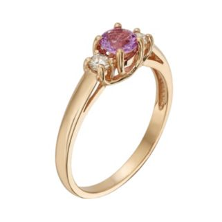 The Regal Collection Pink Sapphire and 1/8 Carat T.W. IGL Certified Diamond 14k Gold 3-Stone Ring