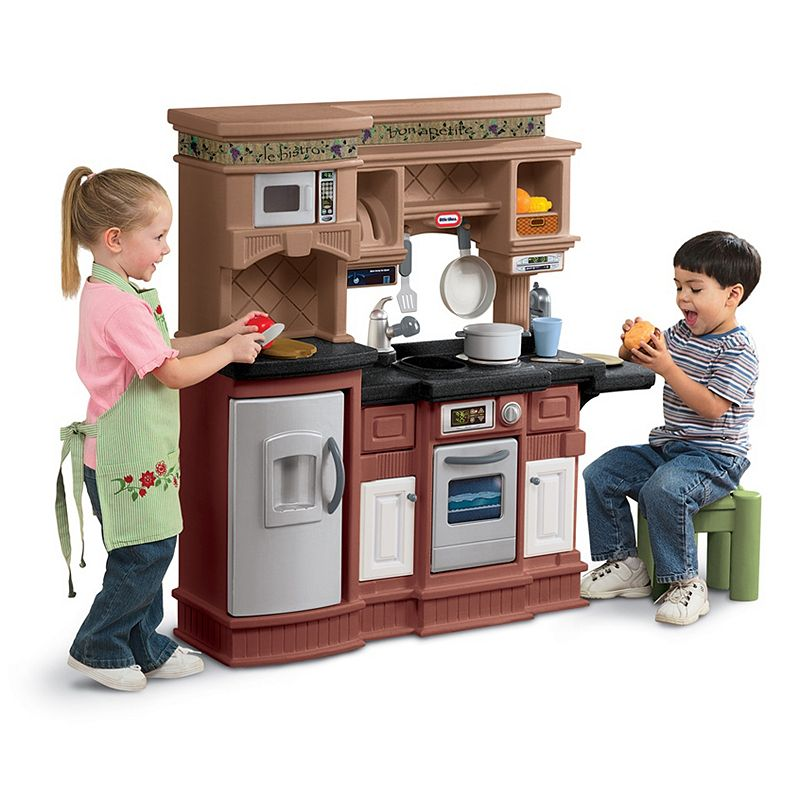 Little Tikes Gourmet Prep 'n Serve Kitchen, Clrs Pull up a seat and grab a bite at this ultra-modern gourmet-style kitchen playset by Little Tikes, featuring separate cooking and eating areas and real cooking noises.Gift Givers: This item ships in its original packaging. If intended as a gift, the packaging may reveal the contents. Plastic mimics granite countertops & stainless steel appliances for a sleek look Plenty of surface & prep area space Microwave, refrigerator & oven with working doors Electronic stove burners make real cooking sounds Plenty of cabinets for storage space Play phone adds to the fun WHAT'S INCLUDED Kitchen playset 18-pc. accessory set 41 x 45 x 10 Kitchen weight: 28.5 lbs. Ages 3 years & up Manufacturer's 1-year limited warrantyFor warranty information please click here Kitchen: requires 2 AA batteries (not included) MODEL NUMBER 619717P  Size: One Size. Color: Clrs. Gender: unisex. Age Group: kids. Material: Stainless Steel/Plastic.