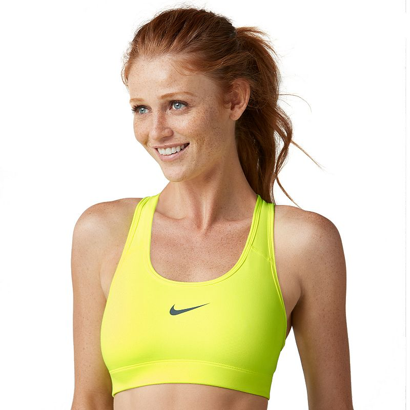 Nike Victory Compression Dri-FIT Medium-Impact Sports Bra 375833, Women's, Size: Small, Drk Yellow With a low profile and racerback design, this women's Nike Victory compression sports bra is a versatile, everyday favorite. From warm up to cool down, this women's Nike sports bra will be there to support you through your most intense workouts. How to Choose a Sports Bra Watch the product video here.NIKE Perfect for medium-impact exercises such as biking Nike Dri-FIT moisture-wicking technology keeps you cool and dry Low-profile bonded seams provide comfort during workouts Racerback sports bra offers great range of motion Wire-free sports bra provides comfortable support Style no. 375833 NIKE FIT & SIZING Compressive fit helps keep muscles warm NIKE FABRIC & CARE Polyester, spandex Machine wash Imported FREQUENTLY ASKED QUESTIONS How to wash Nike sports bra? This women's sports bra from Nike is machine washable for simple care and added convenience. How to wear Nike sports bra? This women's sports bra from Nike can be paired with almost any other athletic apparel. When choosing a sports bra, the band should fit snugly, but should not cause any pain. The shoulder straps should not dig into your skin or ever hurt. To be sure you're choosing the right size for your body, review the Nike Size Chart below for detailed information on women's sports bra size measurements. What size women's Nike sports bra should I get? Check out the women's Nike Size Chart below for detailed information on size measurements. Where to buy women's sports bras from Nike? all women's sports bras from Nike. Size: Small. Color: Drk Yellow. Gender: female. Age Group: adult. Pattern: Solid. Material: Poly Blend.
