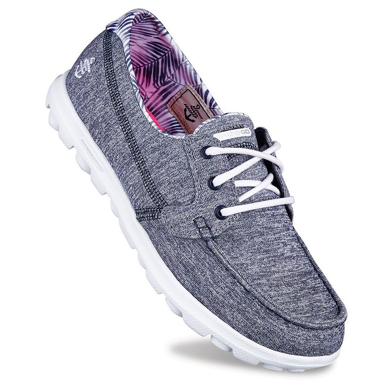 The medium fits my size 10 foot perfectly. They are very comfortable & I have been wearing this style of memory foam Sketchers for several years now.