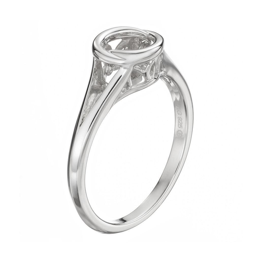 Brilliance in Motion 1/10 Carat T.W. Diamond Sterling Silver Circle Ring