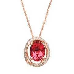 Ruby & 1/10 Carat T.W. Diamond 10k Rose Gold Halo Pendant Necklace
