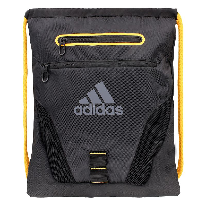 Adidas Rumble Drawstring Backpack, Black Compact and sporty, this Adidas Rumble sackpack is perfect for any trip. Tricot-lined media pocket is perfect for electronics. Exterior zipper pockets offer added storage. Main compartment is ventilated with air mesh to keep gear dry. Drawstring shoulder straps adjust and close with ease. 600-denier polyester Manufacturer's lifetime limited warrantyFor warranty information please click here Wipe clean In-use: 19''H x 15''W x 2''D Weight: 0.5 lbs. Exterior: 2 front zip pockets Interior: 1 main compartment Zipper & drawstring closures Model numbers: Black silver: 5137725 Heather gray blue: 5137709 Bold blue yellow: 5137694 Red print: 5137741 Size: Onesize. Gender: Unisex.