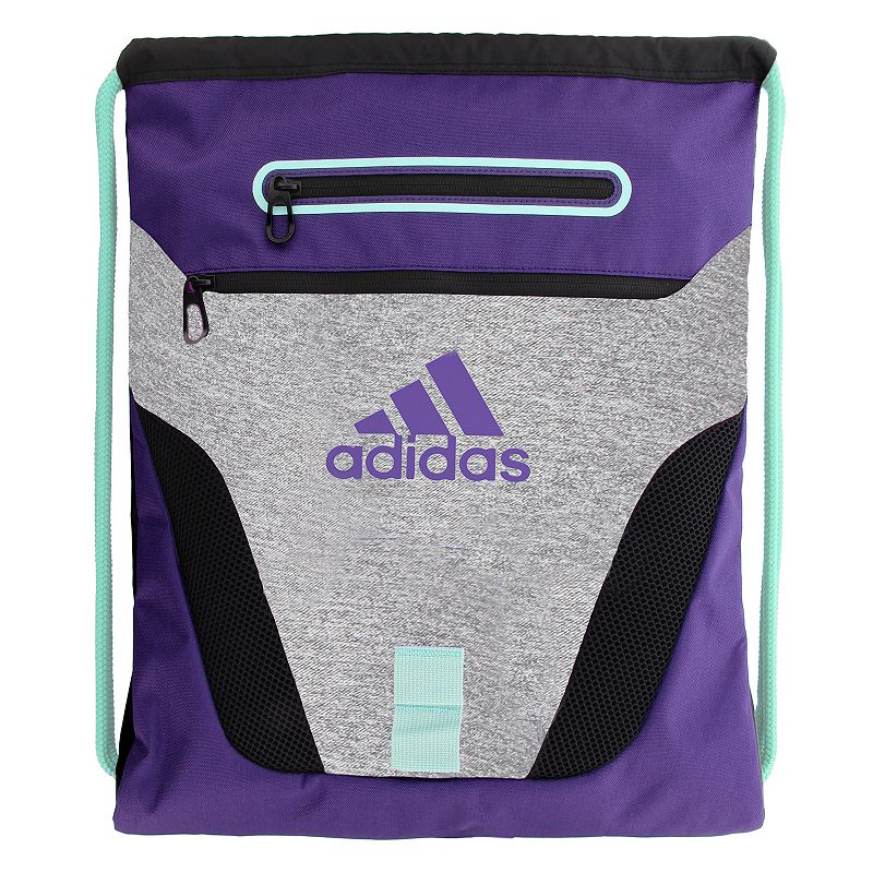 Adidas Rumble Drawstring Backpack, Purple Compact and sporty, this Adidas Rumble sackpack is perfect for any trip. Tricot-lined media pocket is perfect for electronics. Exterior zipper pockets offer added storage. Main compartment is ventilated with air mesh to keep gear dry. Drawstring shoulder straps adjust and close with ease. 600-denier polyester Manufacturer's lifetime limited warrantyFor warranty information please click here Wipe clean In-use: 19''H x 15''W x 2''D Weight: 0.5 lbs. Exterior: 2 front zip pockets Interior: 1 main compartment Zipper & drawstring closures Model numbers: Black silver: 5137725 Heather gray blue: 5137709 Bold blue yellow: 5137694 Red print: 5137741 Size: One Size. Color: Purple. Gender: Unisex.