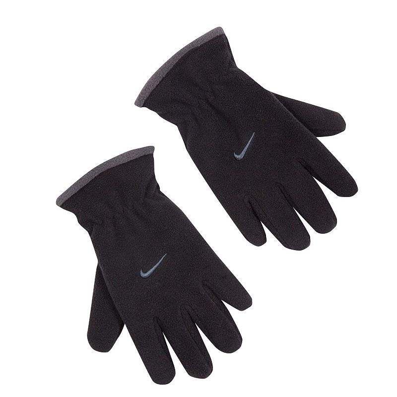 Boys Nike Microfleece Gloves, Black Fight back against winter with these boys' Nike microfleece gloves. Embroidered Nike swoosh logo FIT & Sizing One size fits all Fabric & Care Polyester Hand wash Imported Color: Black. Gender: Male. Age Group: Kids. Pattern: Solid.