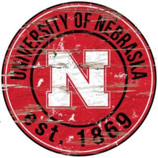 """Nebraska Cornhuskers Distressed 24"""" x 24"""" Round Wall Art"""