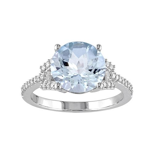 10k White Gold Blue Topaz & 1/6 Carat T.W. Diamond Ring
