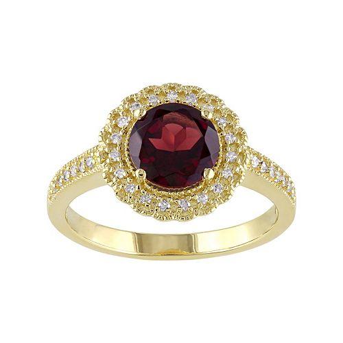 Sterling Silver Garnet & 1/8 Carat T.W. Diamond Halo Ring