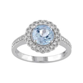 Stella Grace Sterling Silver Sky Blue Topaz & 1/8 Carat T.W. Diamond Halo Ring