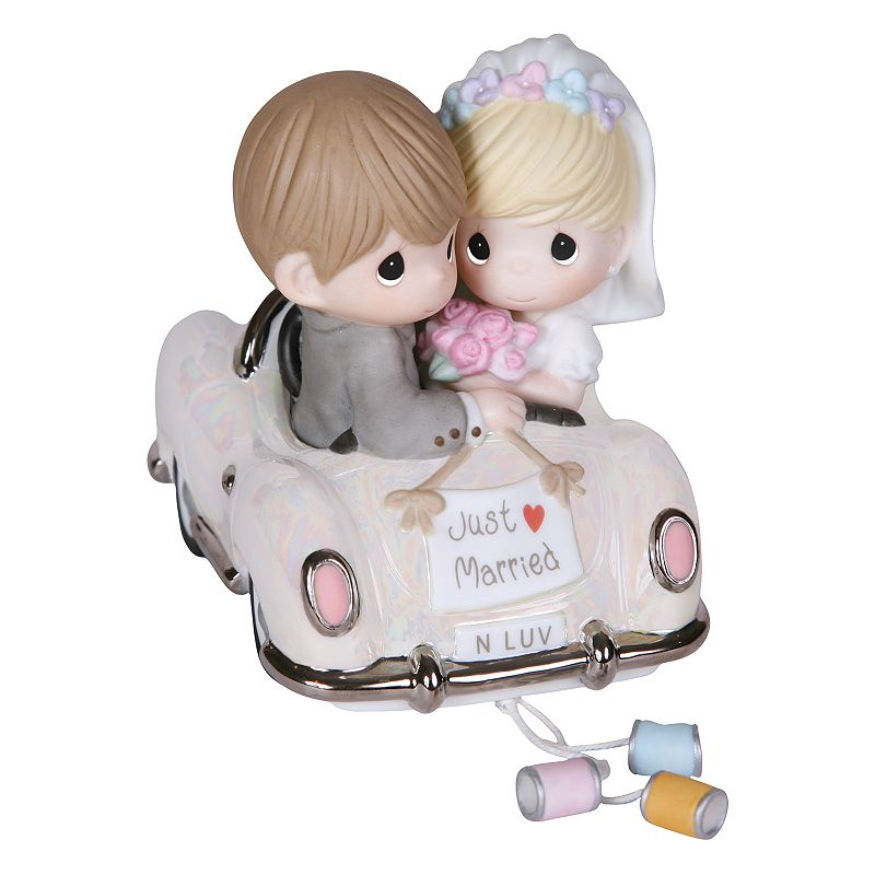 Precious Moments ''Just Married'' Bride & Groom In Car Figurine This Precious Moments figurine captures newlywed love perfectly. 6.15''H x 3.47 W x 2.44''D Porcelain Wipe clean Model no. 103018  Size: One Size. Color: Multicolor. Gender: unisex. Age Group: adult.