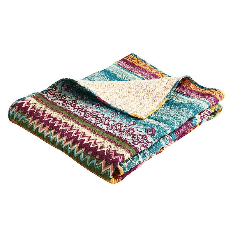 Add warm touch to your decor with this Southwest quilted throw. In multi. FEATURES 50\\\'\\\' x 60\\\'\\\' Southwest-inspired motifs Reversible Bound edges for durability Moisture wicking CONSTRUCTION & CARE Cotton Cotton fill Machine wash Imported  Size: One Size. Color: Multicolor. Gender: unisex. Age Group: adult. Pattern: Western/Southwestern.