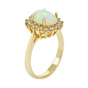 The Regal Collection 14k Gold Opal & 1/2 Carat T.W. Diamond Halo Ring