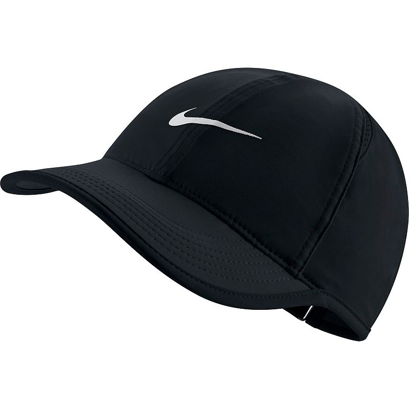 Women's Nike Featherlight Dri-FIT Hat, Grey Sport this Nike women's Featherlight adjustable hat. Its Dri-FIT technology helps eliminate moisture for lasting dryness, so you'll always enjoy a comfortable workout. Moisture-wicking technology Mesh side panels for breathability Embroidered Nike Swoosh adds sporty style Adjustable closure ensures a customized fit FIT & SIZING One size fits most FABRIC & CARE Polyester Hand wash Imported Hit your fitness goals with Kohl's healthy selection of coordinating exercise accessories and equipment for women by Nike. Pull your hair back with an adjustable hat, experience freedom of movement with running tights and hit your stride with shock-absorbing training shoes. For a flattering look while you get fit, mix and match high-energy solids with playful patterns and inspiring messages. Enjoy peak physical performance with Nike's advanced Dri-FIT wicking properties and lightweight fabrics. Ventilated insulation and rain protection helps you keep up with your fitness routine in any condition. Whether you're focused on speed and agility or range of motion, Nike has you covered with sport-specific shoes and clothing. Conquer the court and dominate the field with the legendary comfort and convenience of Nike sporting goods products. Color: Charcoal. Gender: female. Age Group: adult.