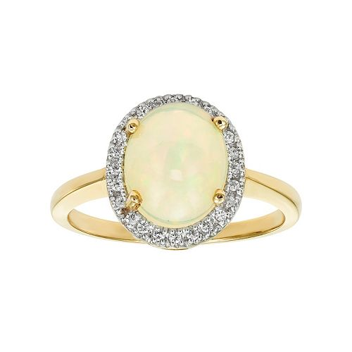The Regal Collection 14k Gold Opal & 1/8 Carat T.W. Diamond Halo Ring