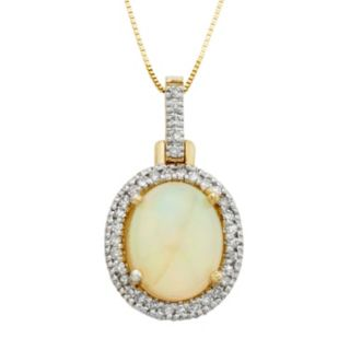 The Regal Collection 14k Gold Opal & 1/6 Carat T.W. Diamond Halo Pendant