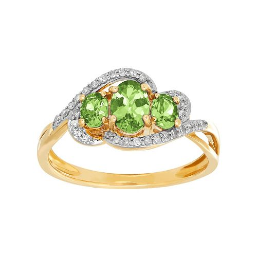 10k Gold Peridot & 1/8 Carat T.W. Diamond 3-Stone Ring
