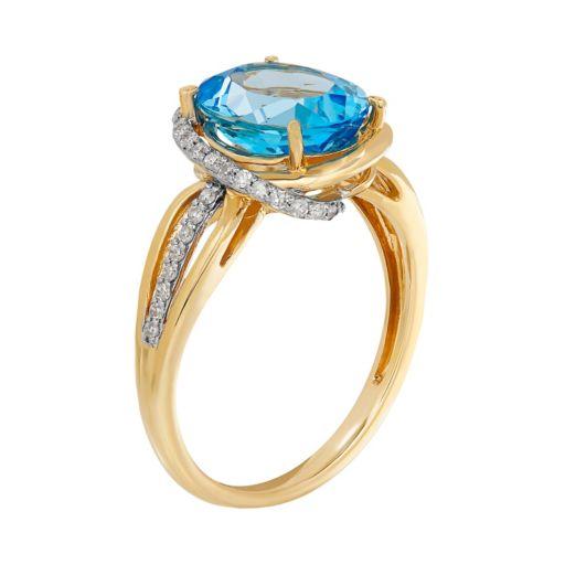10k Gold Blue Topaz & 1/6 Carat T.W. Diamond Halo Ring