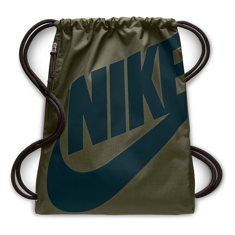Nike Heritage Drawstring Backpack, Green Show off your sporty style with this convenient Nike Heritage gym sack. Roomy main compartment Easy-access side zip pocket holds your valuables Durable lightweight design 17 H x 13 W Weight: 0.5 lbs. Polyester Drawstring closure Model Numbers Gray black: BA5351-009 Black white: BA5351-011 Black silver: BA5351-013 Pink gym red: BA5351-627 Gym red black: BA5351-657 Size: One Size. Color: Green.