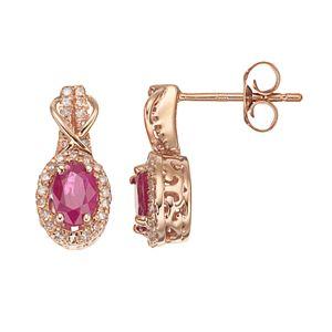 10k Rose Gold Ruby & 1/4 Carat T.W. Diamond Halo Stud Earrings
