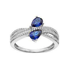 10k White Gold Sapphire & 1/4 Carat T.W. Diamond Bypass Ring