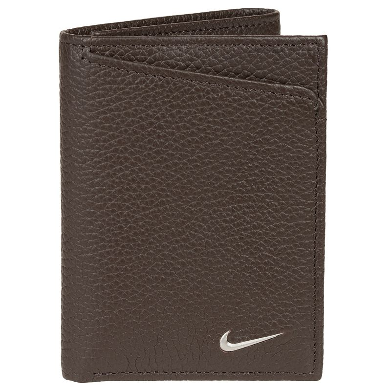 Men's Nike Leather Wallet, Brown Cash in. This men's Nike wallet features plenty of storage space for cards and cash. Pebbled leather construction Seven card slots Two slip pockets Currency compartment Mesh ID window Packaged in a reusable storage tin 4 H x 4.5 W Leather Imported Size: Onesize. Color: Brown. Gender: Male. Age Group: Adult.