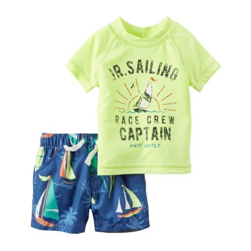 "Baby Boy Carter's Short Sleeve ""Jr. Sailing Race Crew Captain"" Rashguard & Sailboat Swim Trunks Set"