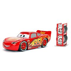 Disney/Pixar Cars 1:24 Lightning McQueen Die Cast w/Tire Rack  by Jada Toys
