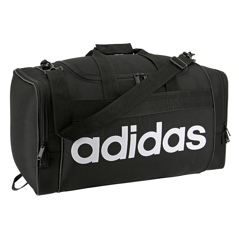 Adidas Santiago Duffel Bag, Black Boasting classic Adidas style, this Adidas Santiago duffel bag carries your gear with ease while turning a few heads. Durable 750 denier polyester for lasting use Spacious, zippered main compartment holds all of your gear Dual zippered end pockets hold accessories and keeps items organized Adjustable shoulder strap for comfortable carrying 11 H x 21.5 W x 11 D Weight: 1.6 lbs. Polyester Zipper closure Manufacturer's lifetime limited warrantyFor warranty information please click here Model Numbers Black: 5143963 Aero pink: 5143986 Onix jersey: 5143955 Easy green: 5143961 Noble indigo: 5144376 Size: Onesize. Gender: Unisex.