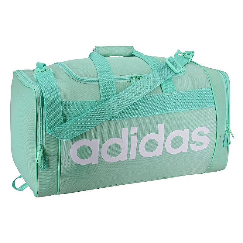 Adidas Santiago Duffel Bag, Green Boasting classic Adidas style, this Adidas Santiago duffel bag carries your gear with ease while turning a few heads. Durable 750 denier polyester for lasting use Spacious, zippered main compartment holds all of your gear Dual zippered end pockets hold accessories and keeps items organized Adjustable shoulder strap for comfortable carrying 11 H x 21.5 W x 11 D Weight: 1.6 lbs. Polyester Zipper closure Manufacturer's lifetime limited warrantyFor warranty information please click here Model Numbers Black: 5143963 Aero pink: 5143986 Onix jersey: 5143955 Easy green: 5143961 Noble indigo: 5144376 Size: One size. Gender: Unisex.