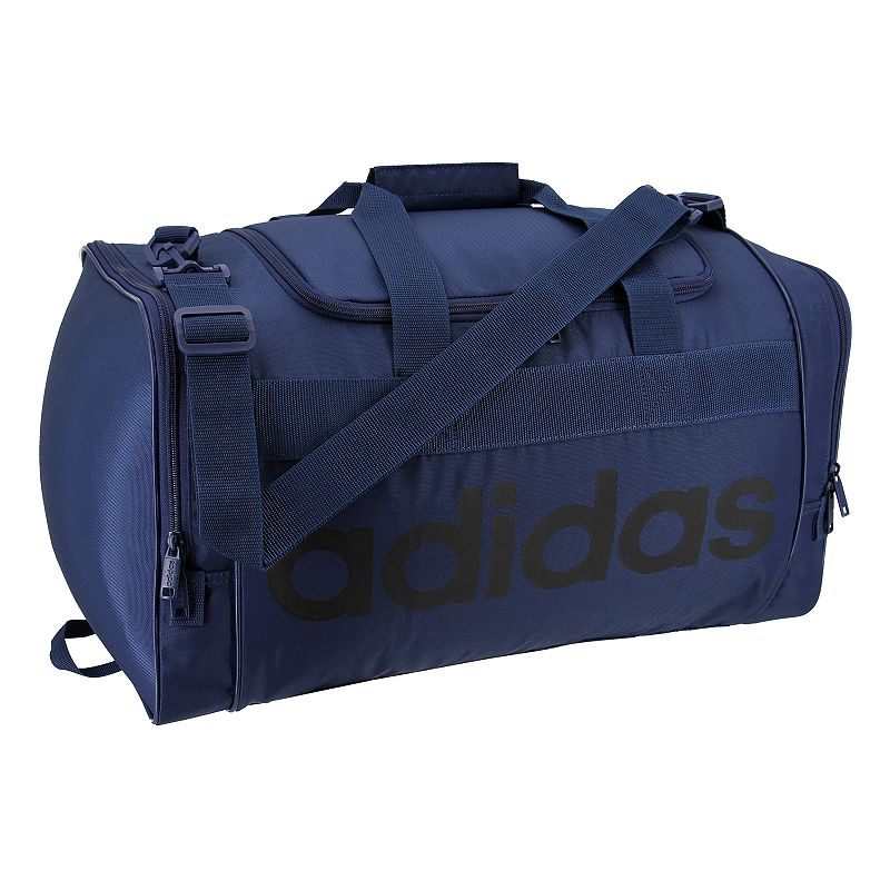 Adidas Santiago Duffel Bag, Blue Boasting classic Adidas style, this Adidas Santiago duffel bag carries your gear with ease while turning a few heads. Durable 750 denier polyester for lasting use Spacious, zippered main compartment holds all of your gear Dual zippered end pockets hold accessories and keeps items organized Adjustable shoulder strap for comfortable carrying 11 H x 21.5 W x 11 D Weight: 1.6 lbs. Polyester Zipper closure Manufacturer's lifetime limited warrantyFor warranty information please click here Model Numbers Black: 5143963 Aero pink: 5143986 Onix jersey: 5143955 Easy green: 5143961 Noble indigo: 5144376 Size: One size. Color: Blue. Gender: Unisex.