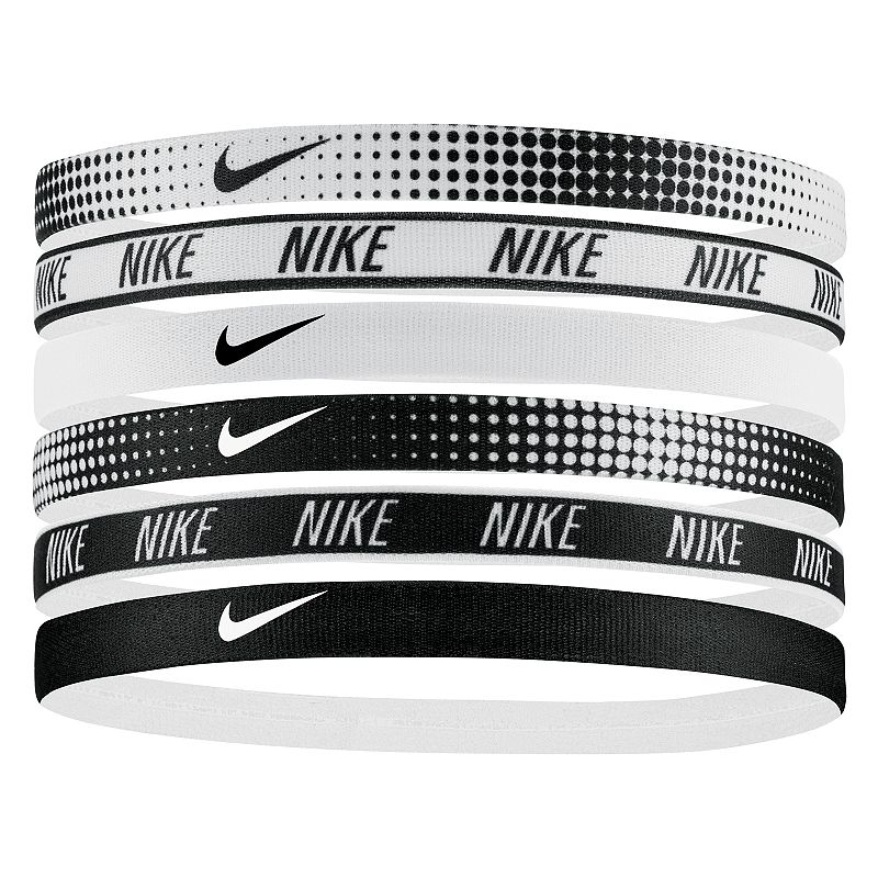 Nike 6-pk. Printed Swoosh Headband Set, White Black Sporty style is effortless with these Nike headbands. 6-pack Silicone grips Swoosh logo FIT & SIZING 0.5 in. width (each) FABRIC & CARE Polyester, rubber, silicone Machine wash Imported Size: One Size. Color: White Black. Gender: female. Age Group: adult. Pattern: printed.