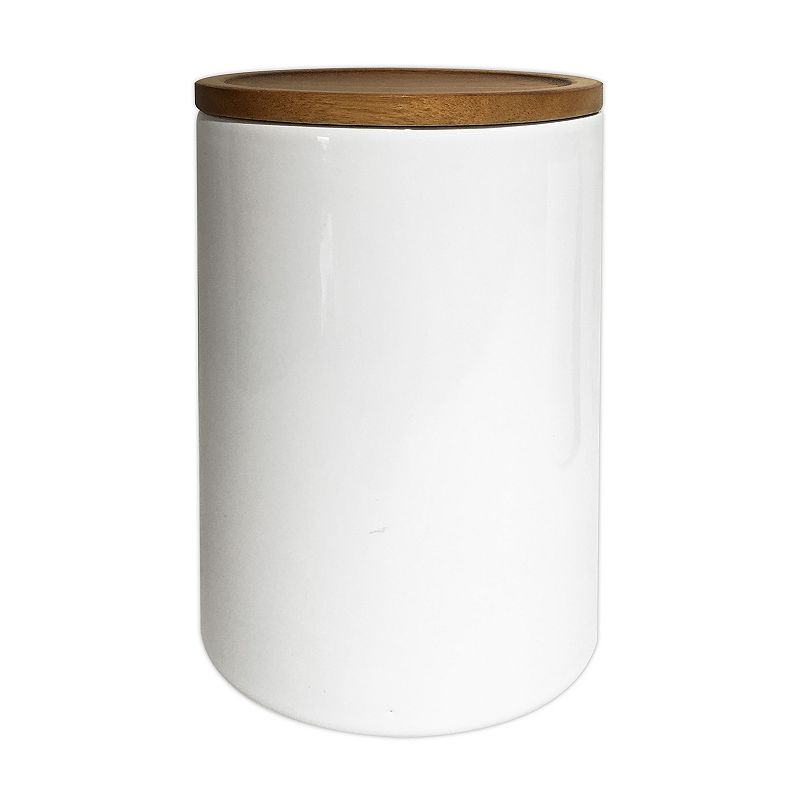 Food Network Large Canister with Acacia Wood Lid, White, LG CANSTER Stylishly store dry goods in this Food Network canister, featuring an attractive acacia wood lid. White ceramic minimalist design Acacia wood lid Ceramic, wood Hand wash 73-oz. capacity 8.5 H x 5 W x 5 D Size: LG CANSTER. Gender: unisex. Age Group: adult. Material: Porcelain.