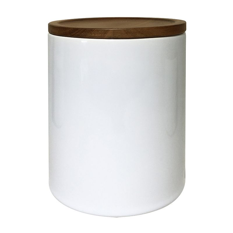 Food Network Medium Canister with Acacia Wood Lid, White, MD CANSTER Stylishly store dry goods in this Food Network canister, featuring an attractive acacia wood lid. White ceramic minimalist design Acacia wood lid Ceramic, wood Hand wash 59-oz. capacity 7 H x 5 W x 5 D Size: MD CANSTER. Gender: unisex. Age Group: adult. Material: Porcelain.