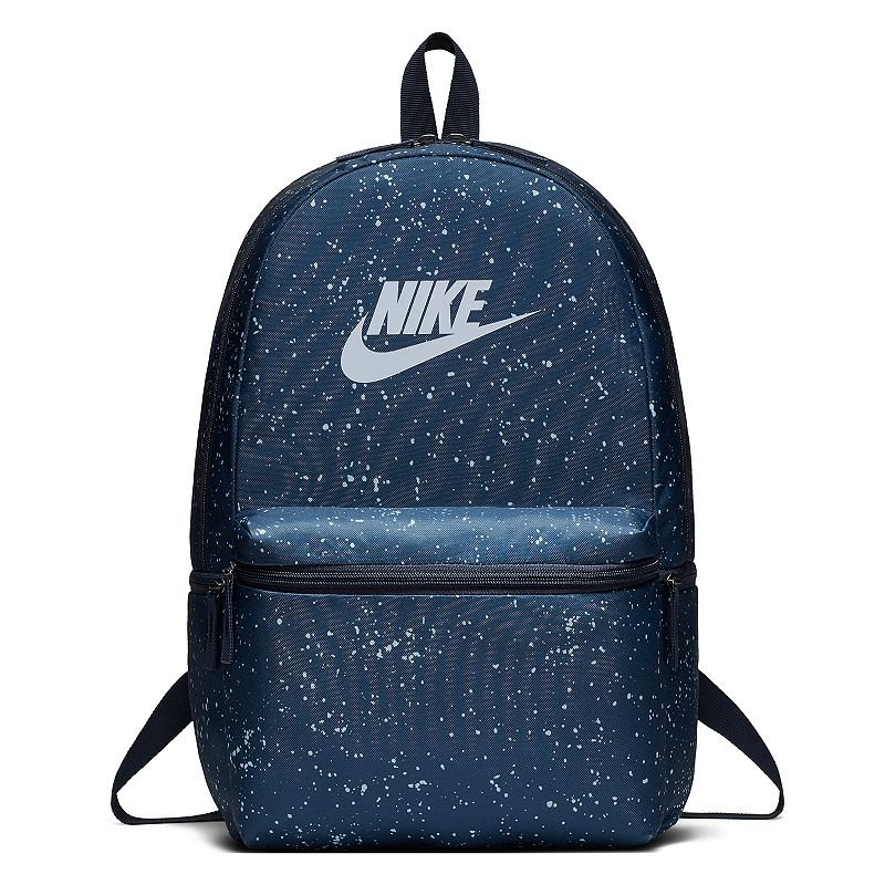 Nike Heritage Backpack, Blue Simplicity and functionality combine in this Nike Heritage backpack with its clean, multi-pocket design. Densely woven polyester provides heavyweight support Zippered main compartment offers room for your gear Internal sleeve can store up to a 15-in. laptop Zippered front pouch provides small-item storage Haul loop at the top for an alternative carrying option Shoulder straps and back panel are padded for comfortable carrying 18 H x 13 W x 7 D Weight: 1 lbs. Polyester Zipper closure Model no. BA5761 Size: One size. Color: Blue.