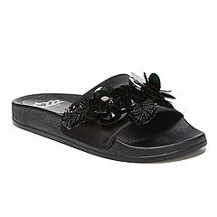 ac232edd83b529 Fergalicious Flame Women s Slide Sandals. Black