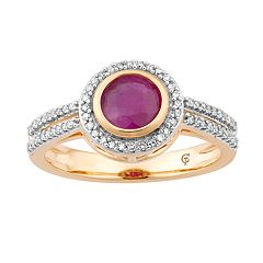 10k Gold Ruby & 1/5 Carat T.W. Diamond Halo Ring