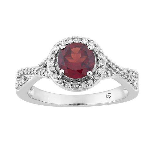 10k White Gold Garnet & 1/4 Carat T.W. Diamond Halo Ring