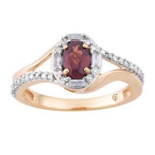 10k Gold Garnet & 1/4 Carat T.W. Diamond Oval Halo Ring