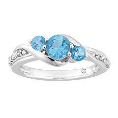10k White Gold Swiss Blue Topaz & 1/10 Carat T.W. Diamond 3-Stone Ring