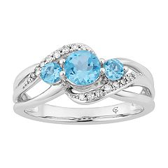 10k White Gold Swiss Blue Topaz & 1/5 Carat T.W. Diamond 3-Stone Ring