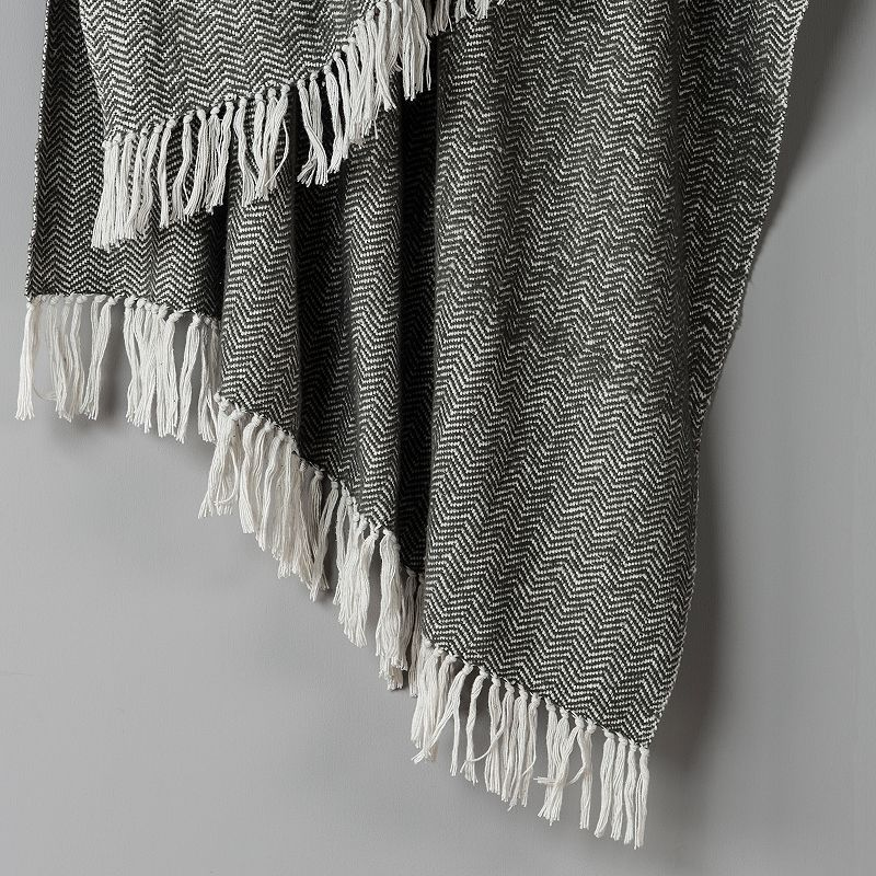 Add a stylish addition to your couch with this herringbone throw. 50\\\'\\\' x 60\\\'\\\' Reversible Woven herringbone design CONSTRUCTION AND CARE Cotton Machine wash Imported Size: One Size. Color: Grey. Gender: unisex. Age Group: adult.