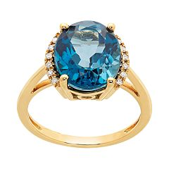 10k Gold Blue Topaz & 1/10 Carat T.W. Oval Halo Ring