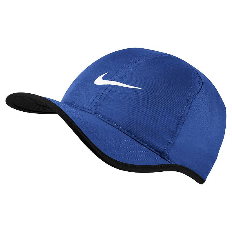 Nike Featherlight Baseball Cap, Blue Embroidered Nike Swoosh adds sporty style. Adjustable closure ensures a customized fit. Details: One size fits most Adjustable back strap Polyester Hand wash Imported Size: Onesize. Color: Blue. Gender: Male.